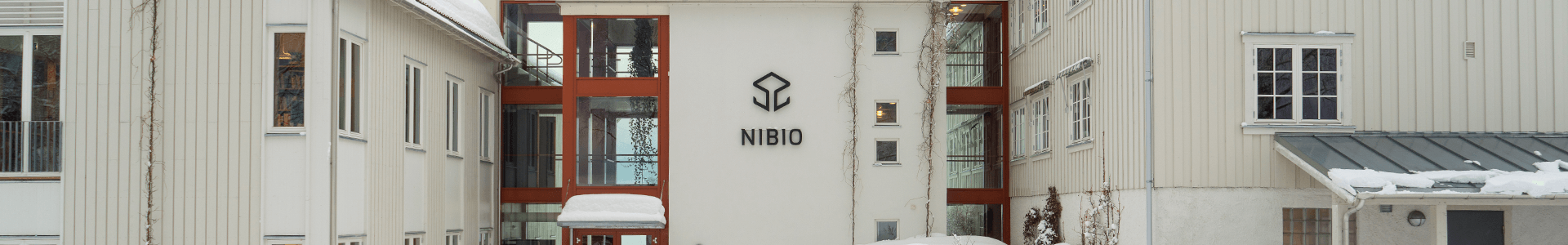The picture of Contact shows the NIBIO Apelsvoll building