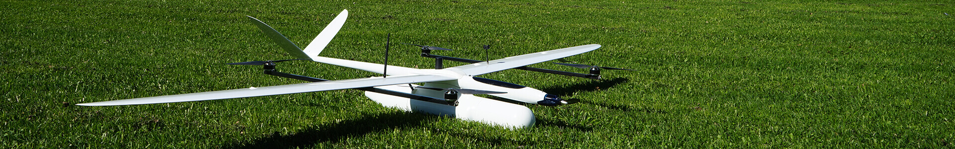 The picture shows a UAV in the grass